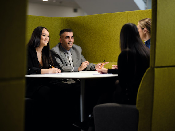 Derbyshire Constabulary Jobs | Careers Website | Two White Female Police and Asian Male Police Staff Members in Meeting Image.jpg