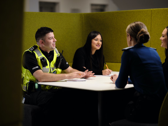 Derbyshire Constabulary Jobs | Careers Website | White Male Police Officer and Asian Female Police Staff Member and White Female Police Officer in Meeting Image.jpg