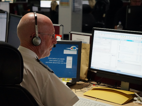 Derbyshire Constabulary Jobs | Careers Website | White Male Police Staff Member Taking a Call Image.JPG