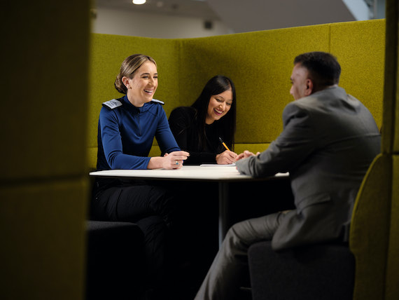 Derbyshire Constabulary Jobs | Careers Website | White Female Police Officer and Asian Female Police Staff Member and Asian Male Police Staff Member in Meeting Image.jpg