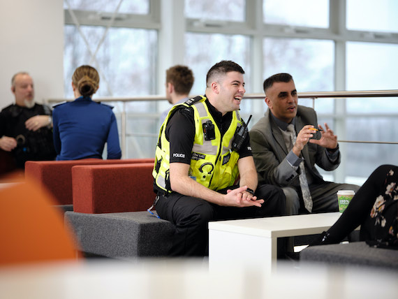 Derbyshire Constabulary Jobs | Careers Website | White Male Police Officer Listening to an Asian Police Staff Member Image 2.jpg