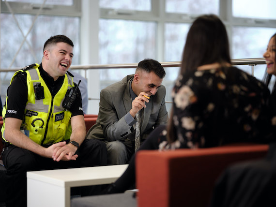 Derbyshire Constabulary Jobs | Careers Website | White Male Police Officer Laughing with an Asian Police Staff Member Image.jpg
