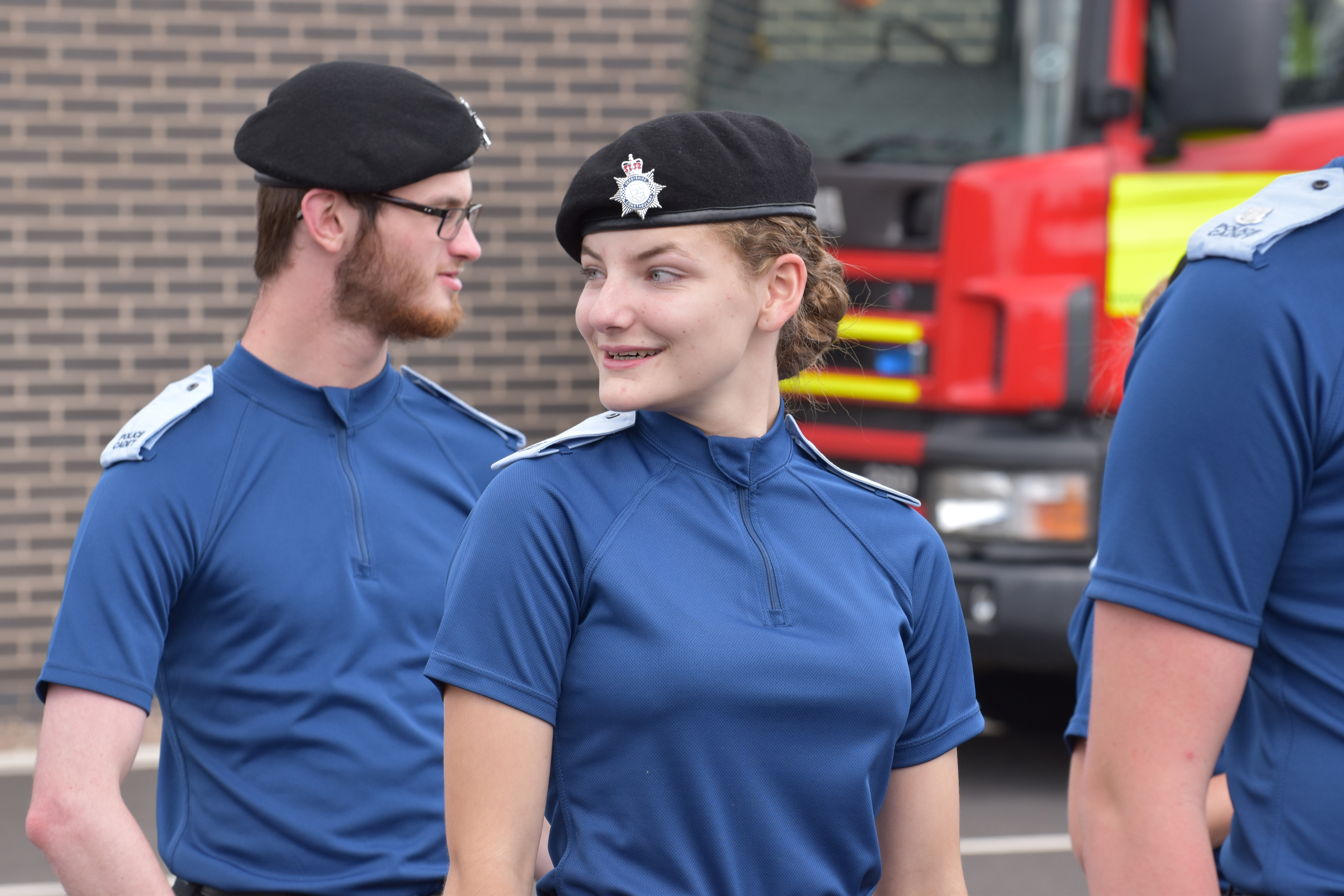 A cadet smiles whilst on parade