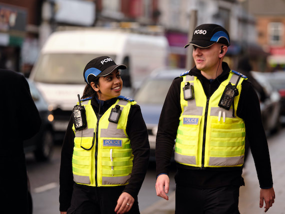 Derbyshire Constabulary Jobs | Careers Website | Asian Female and White Male Police Officers Walking Down Street Image.jpg