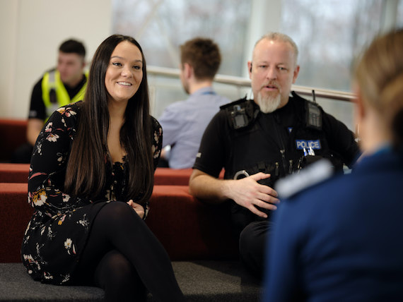 Derbyshire Constabulary Jobs | Careers Website | White Female Police Staff Member and White Male Police Officer Listening Image.jpg